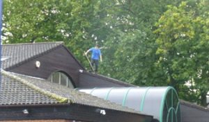Man on roof without protection