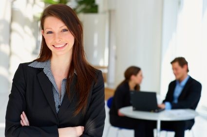 Portrait of a young female in front of a workgroup
